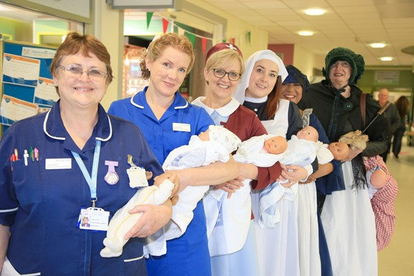 Trust midwives pictured representing 2000s, 1970/80s, 1930/40s, 1860s, 1840s, and 15th century