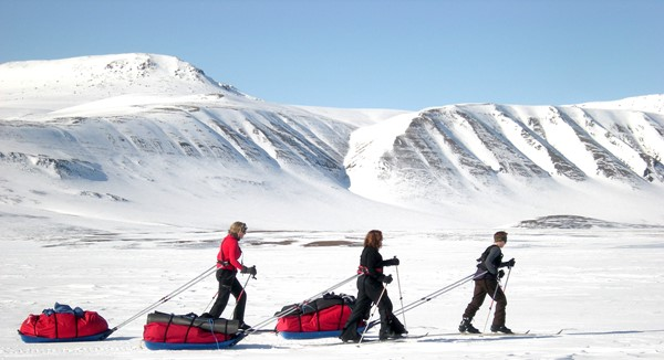 Jane heads her team of three across one of the remote Arctic valleys