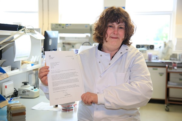 Consultant microbiologist Alison Johnson with the letter from Jeremy Hunt