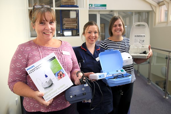 Left to right: Julie Manning, Lead Respiratory Nurse Specialist, Hannah James Ward Respiratory Nurse and Lisa Rees, Oxygen Nurse, are pictured with a selection of the nebulisers which patients may have in their homes and which the hospital is asking to be returned if they are not being used.