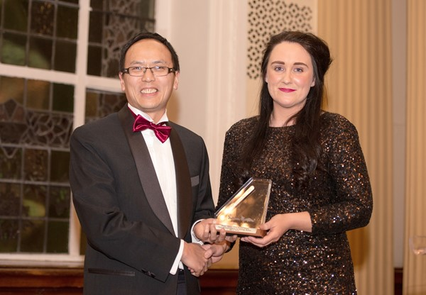 WVT Edmund Leung receives the silver scalpel award from Christina Fleming, vice president of the Association of Surgeons in Training.
