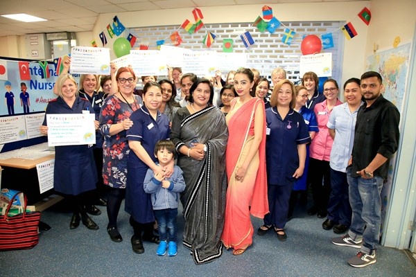 Coming together to celebrate International Nurses Day at Hereford County Hospital. Tanya Dass is pictured at the front in red.