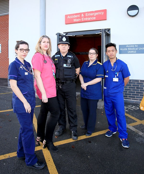 Pictured outside the Emergency Department are, left to right: Junior Sister Kelly Moran, ED Consultant Rachel McColm, PC Chris Lea, ED Lead Nurse Lou Weaver and Dr John Piedad.